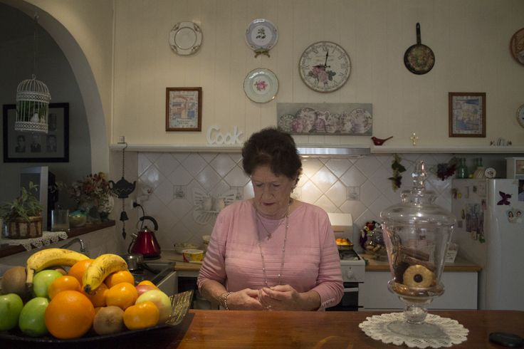 nanas how is filled with little nick nacks and i love how you can see that in this image, her kitchen wall filled with things