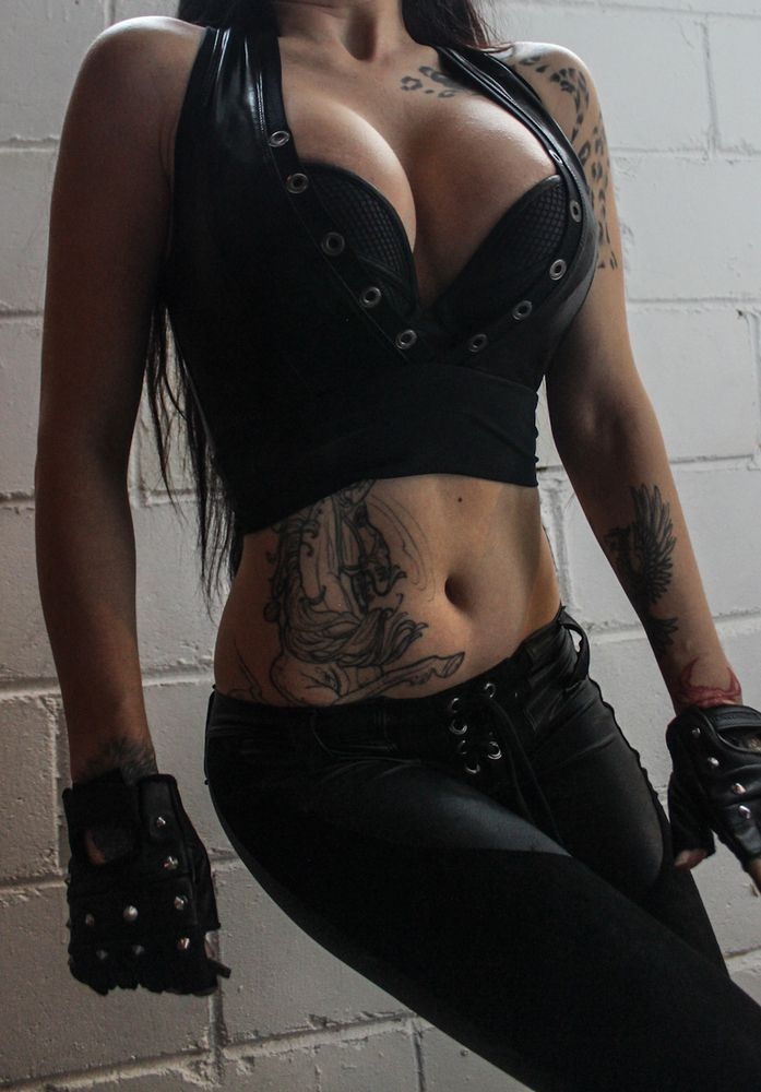 "TOXIC VISION Hell Patrol crop top | Toxic Vision 4.1.15  Made from scratch out of black 4-way stretch pvc with a eyelets up the front!  Size: Small Measures: 30-38"" bust"