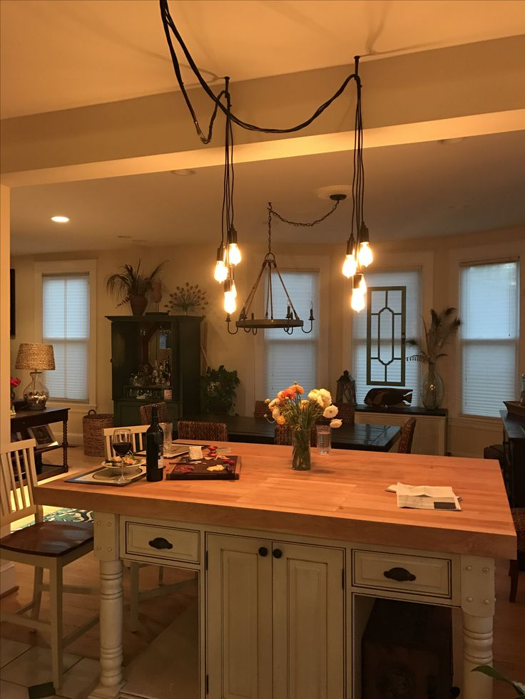 Europa Edison Multi Light Pendant clustered in 2 bunches over our kitchen island