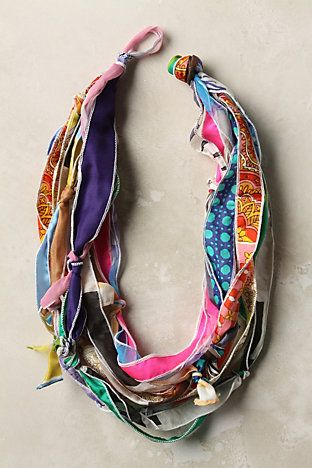 Scarf necklace by We Love Vera, makes for a fun DIY idea! Silk scarves are cut into strips, knotted and strung into a colorful scarf necklace hybrid.