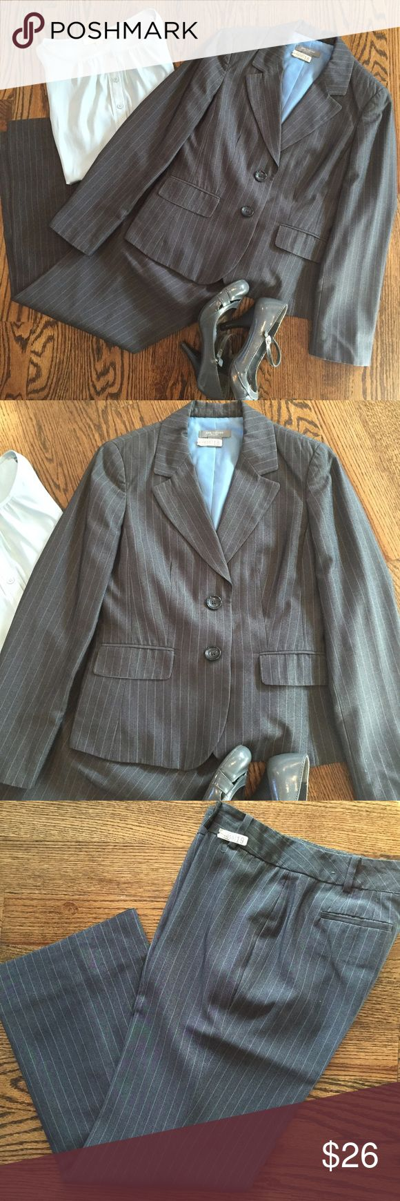 ✨New listing✨Gray & blue Ann Taylor pinstripe suit This gray & blue pinstripe pant suit from Ann Taylor has a classic silhouette.  The jacket is size 4P & is in very good used condition.  The pants have been professionally tailored from the original tagged size of 4P (tags removed in alteration).  The pants as tailored fit like an Ann Taylor 2P (15 in. waist across, 28 in. inseam). The alterations aren't visible when on, but can be seen on inside lining (Pic 4, top) The only flaw in the…