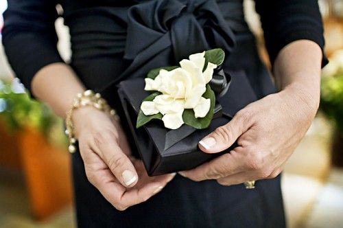 Modern twist on mother of the bride corsages... a clutch flower!  Click and scroll through the photos of this wedding!