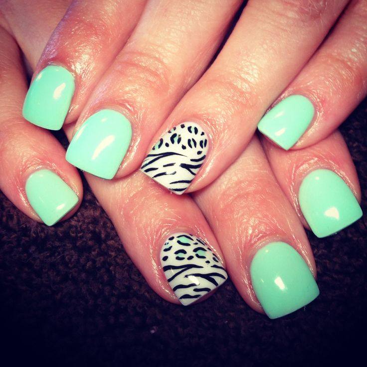 Mint polish with zebra accent nail...I just like the shape of these nails..