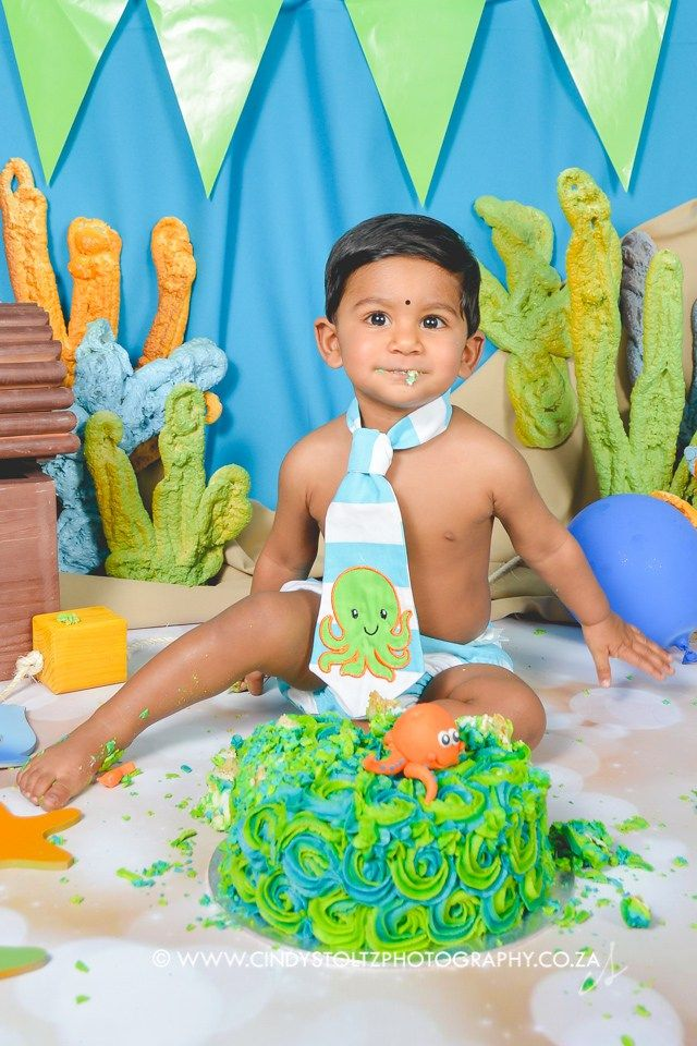 Meet little handsome Kayur. He wasn't into the sweetness that much, but boy, did he have fun smashing his cake! :D Cute little outfit by Subella Baby Boutique Stunning cake as always by Baked…