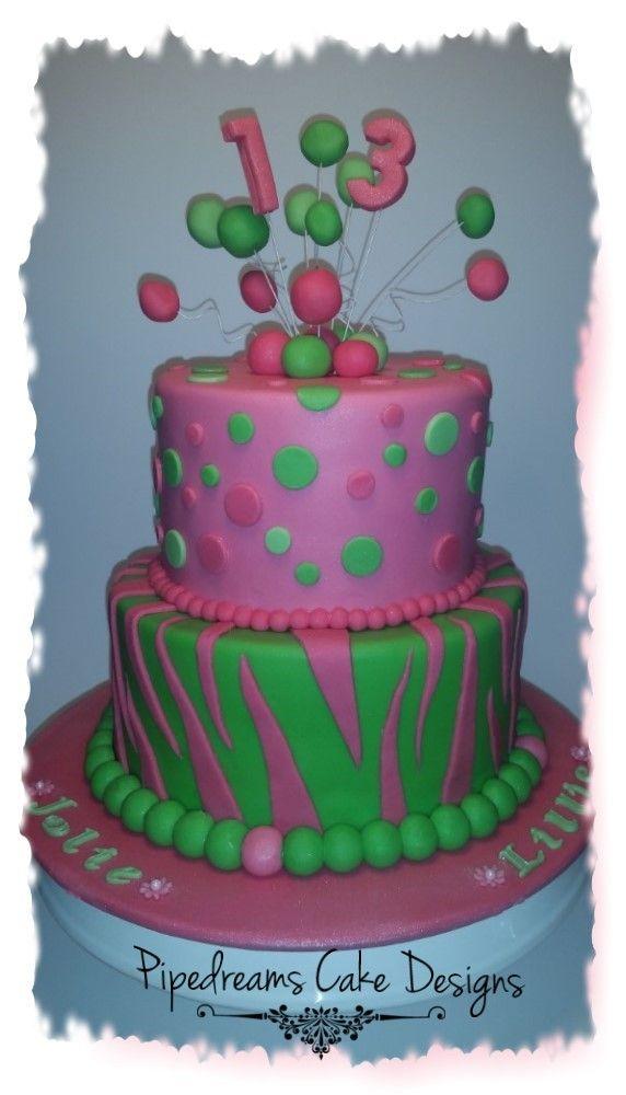 Pink and green zebra stripes and polka dots cake.