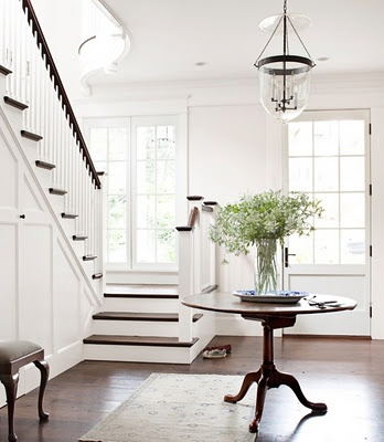 LOVE: Decor Ideas, Lights Fixtures, Stairs, Clean, Dark Wood, White Rooms, Round Tables, White Wall, Entryway