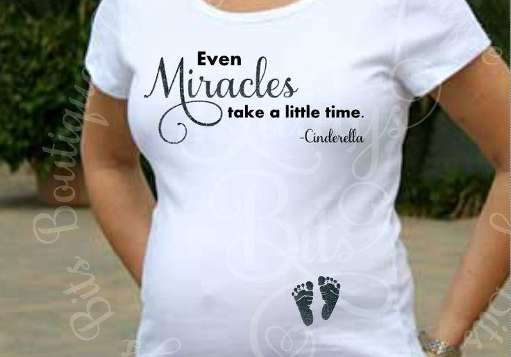 "Maternity Shirt - Even Miracles Take A Little Time - with two footprints on the belly.  Wording can be changed.  I can remove ""Cinderella"".  Footprints can be black, pink, or blue.  I can also use glitter vinyl on the footprints.  Shirt comes in either black or white.  Please specify your color choice in the comments section.  If no choice is made, they will be in black.   PRODUCTION TIME IS UP TO"