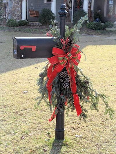 Dress Up Your Mailbox for the Holidays - Fir and pine cone swag with berries and red bells plus a big wire edged ribbon bow.