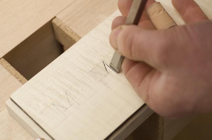 Carving the secret press.