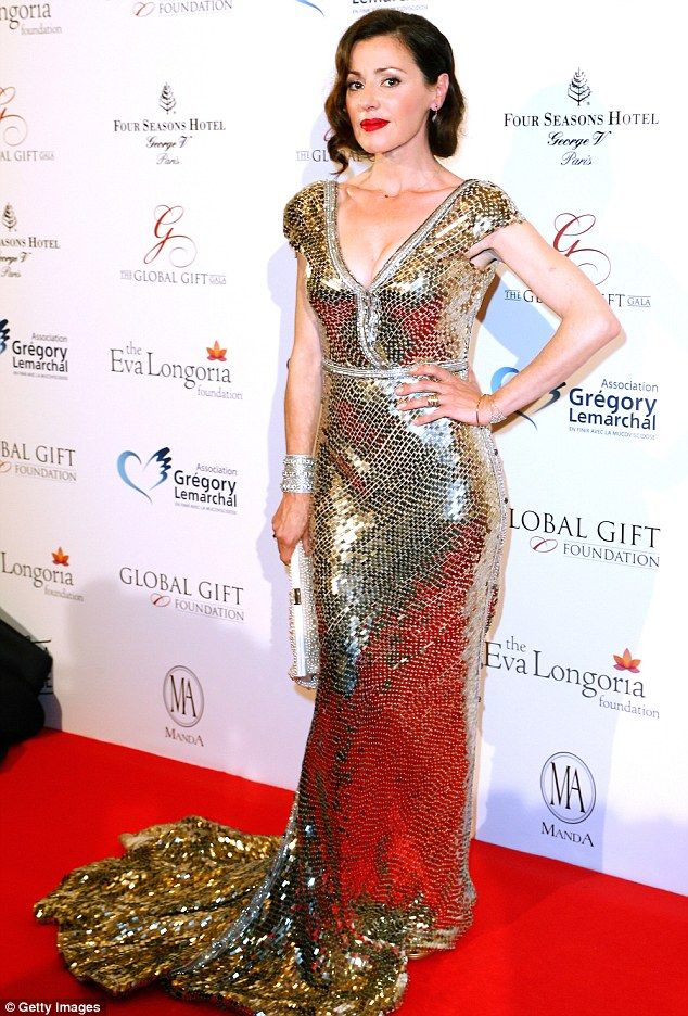 Sparkling: The dress she wore to the event at the Four Seasons George V hotel was by Austr...
