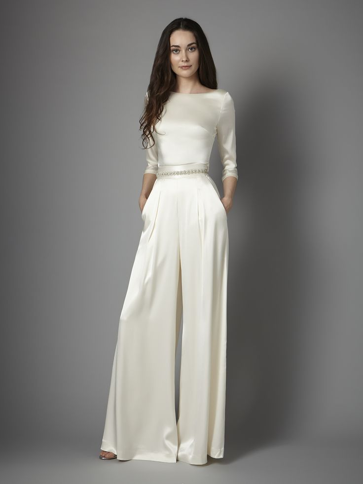 Channeling the luxe, opulent glamour of the 1940's, the Aurelia trousers are a fresh yet modern take on a tailored classic. The wide legged, high-waisted cut combined with flattering box pleats that cleverly conceal the side pockets, these satin trousers are the chicest approach to true individual aisle-style and instant wedding-to-reception glamour.