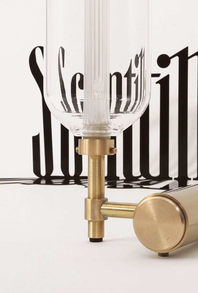 Borosilicate glass lamp is composed of two mouth-blown glass cylinders placed one inside the other.