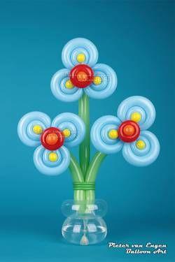 Blue Flowers in a vase by Pieter van Engen
