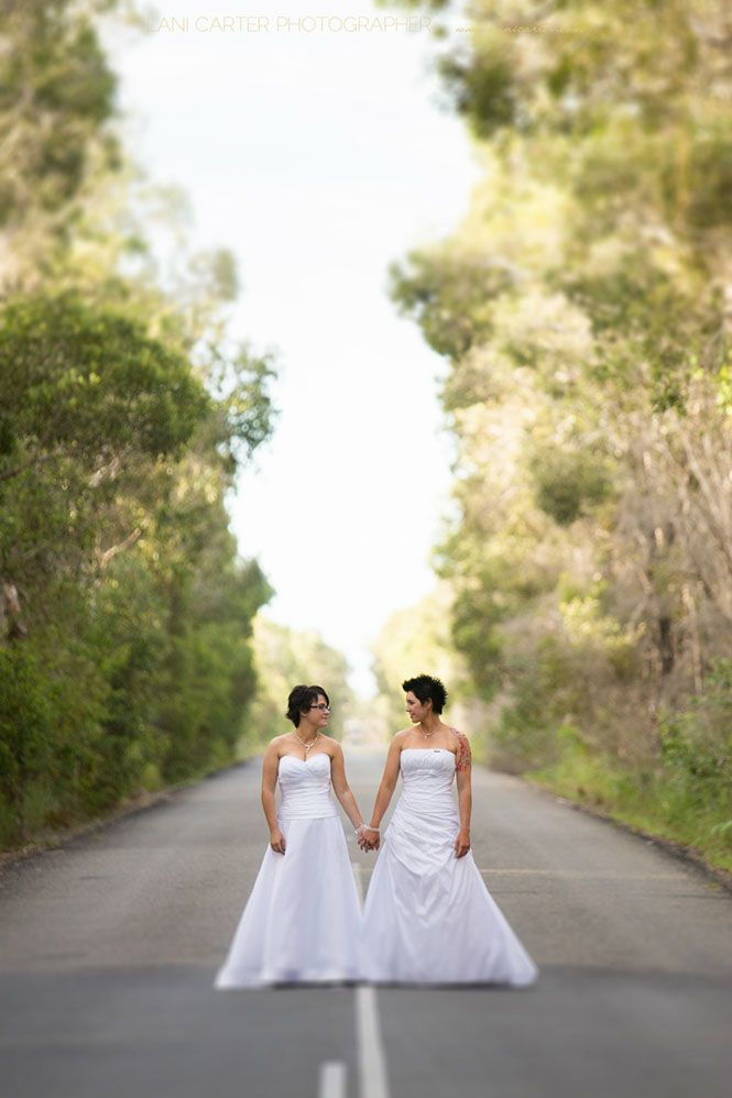 Two brides holding hands at Noosa north shore. Same sex marriage. www.lanicarter.com