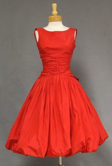 A FABULOUS vintage cocktail dress in cherry red taffeta. Fitted, sleeveless bodice with gathered waist. Dress has a SUPER full skirt with a balloon hem and bow at rear