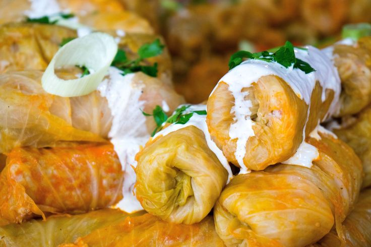 This recipe for Hungarian stuffed cabbage or toltott kaposzta is made with ground pork, beef and sliced smoked pork butt. Sour cream finishes the sauce.