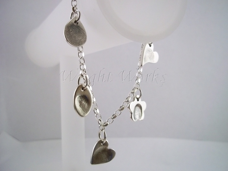 Charm bracelet featuring five gorgeous charms featuring fingerprints in fine silver with an antique finish. Supplied on a sterling silver bracelet