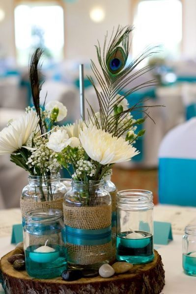 Like the peacock with white flowers (calla Lillie's) & the teal color ribbon and maybe the colored water?