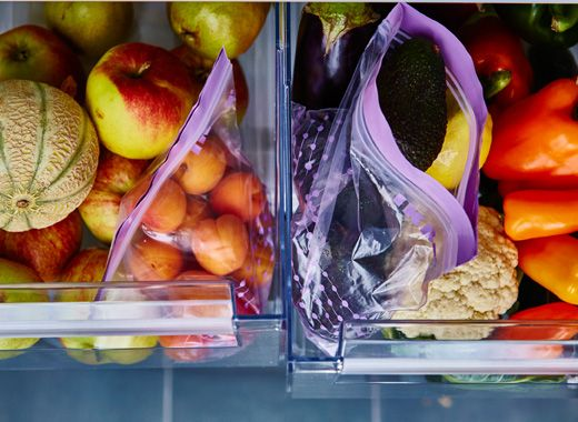 Two produce drawers are open and sorted by fruits and vegetables. Keep in mind that when it comes to fruits and vegetables, like likes like. Put similar ones in the same produce drawer and set it to the correct humidity level.