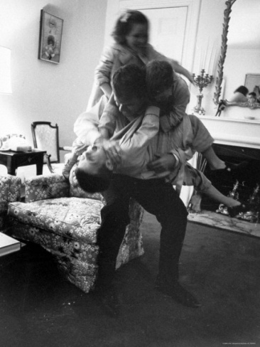 Office art. Robert F. Kennedy and His Children, Playing and Rough Housing, Before Going to Bed Premium Photographic Print by Art Rickerby at Art.com