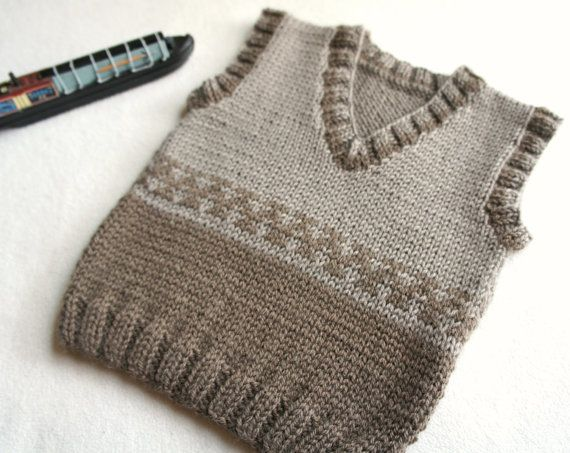 Beige and brovn Hand knitted toddler vest. Made from soft and light weight Baby Yarn 100%wool. This vest could be a great for layering in winter or just over a T-shirt on summer evenings. Measures: 13 long (33 cm), Finished Chest: 21 (56 cm) size 2y Washing machine on gentle in cool water. Hand knit aran tank. Soft, warm, very comfortable for the baby and functional in use.