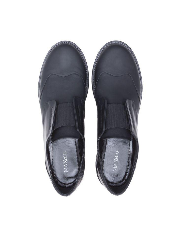 Scarpe maschili di pelle gommata