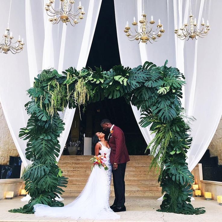 Outdoor wedding with greenery palm arch 219
