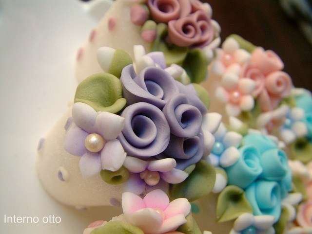 Small pots of flowers in sugar paste.