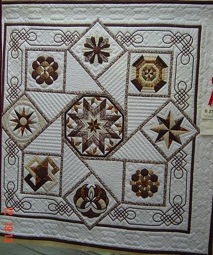 Neutrals ~ the quilting is great and Celtic knot corner borders.