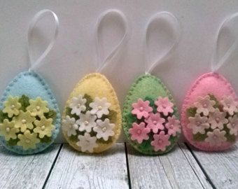 Felt easter decoration - felt eggs with chicken and bunny / set of 2  Listing is for 2 ornament  Handmade from wool blend felt  Size of my decorated eggs is about 2 1/8 x 2 5/8 inch (5,3 x 6,5 cm) This is size of felt egg without hanging loop  This is made to order item