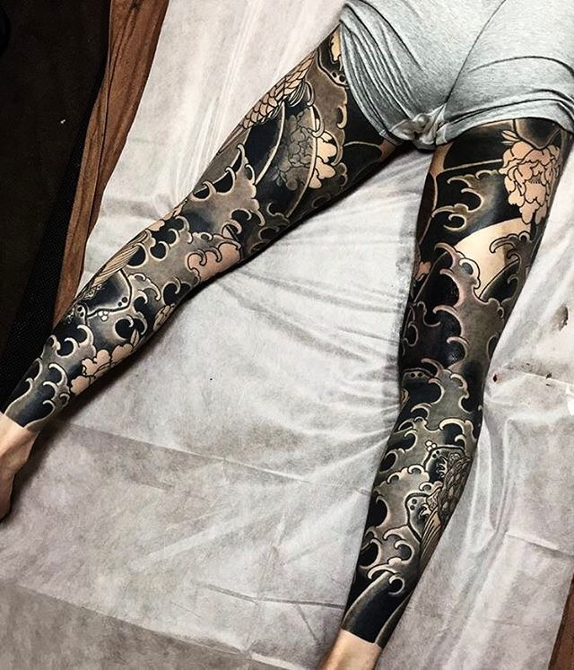 Japanese leg-sleeve tattoos by @horishige_5. #japaneseink #japanesetattoo #irezumi #tebori #bngink #blackandgrey #blackandgreytattoo #cooltattoo #largetattoo #legtattoo #tattoosleeve #legsleeve #flowertattoo #dragontattoo #blackwork #blackink #blacktattoo #wavetattoo #naturetattoo