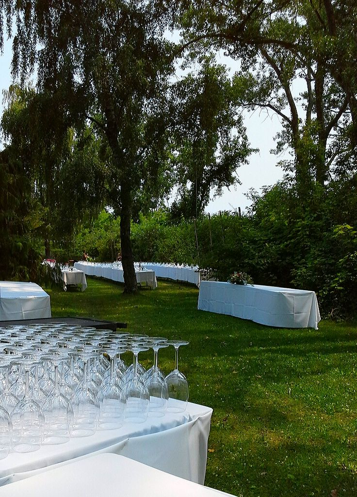 setting up tables and décor on the south and west lawns at Artscape Gibraltar Point, August 8, 2014