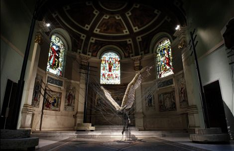 Lucifer (Morning Star) by Paul Fryer  (Installation in the Holy Church in Marylebone, 2008. Anodised aluminium, silicon rubber cord, wax work figure, feathers/aluminium, concrete.)