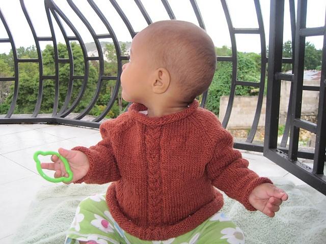 Ravelry: Rolled Edge Raglan Baby Sweater pattern by Joan Marie