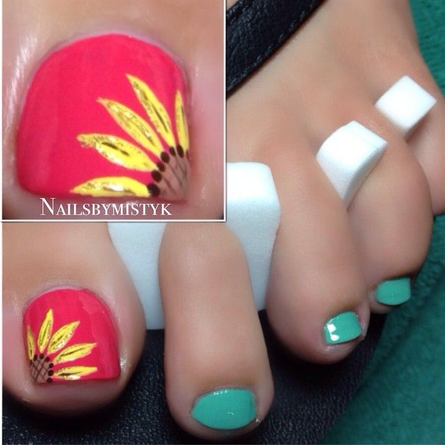 Photo taken by Misty | sunflower accent nail and teal polish