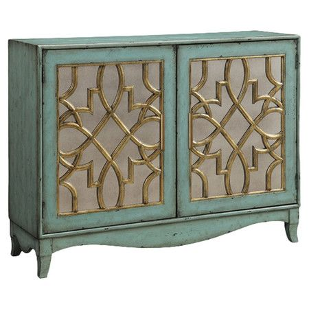 perfect for stowing table linens in the dining room or treasured novels in your den this stylish cabinet features 2 fretwork doors and a soft seafoam