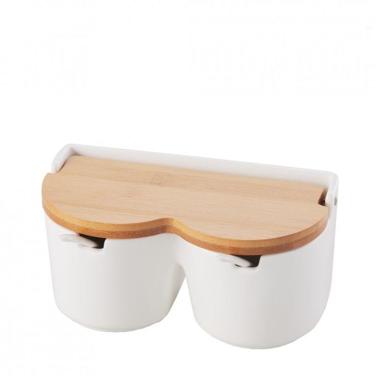 Biały, ceramiczny pojemnik z dwoma przegrodami oraz drewnianą pokrywką. Element stylowej oraz eleganckiej linii Essential.
