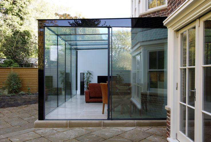 minimal windows sliding doors are the access to and from this frameless glass box and the garden  www.iqglassuk.com