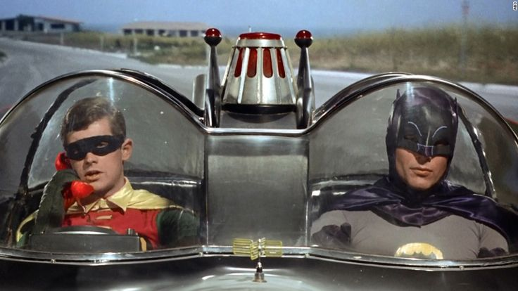 "The ""Batman"" TV series debuted in 1966, starring Adam West as the Caped Crusader and Burt Ward as his sidekick, Robin."
