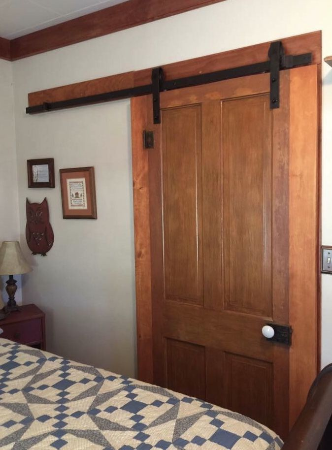New Barn Door hardware with the original 1930's door ... complete with the original knob and key lock plate.  Additional boards must be added to each side to add extensions to cover the doorway opening - providing privacy when closed. The hinges were left in place to add additional artistic history.