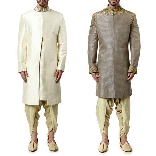 Outfit options for a male guest attending the mehendi ceremony. Chic White Sherwani and Light Grey Sherwani by WYCI. #indianattire #indianweddingoutfit #sherwani
