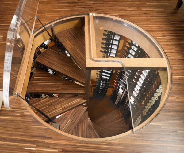 Spiral staircase leading into a wine cellar that saves up on space