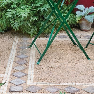 "A breathtaking way to reduce high-maintenance lawn: create an affordable gravel ""patio"" with DIY border. BAM. Photo: Judy White/Gardenphotos.com 