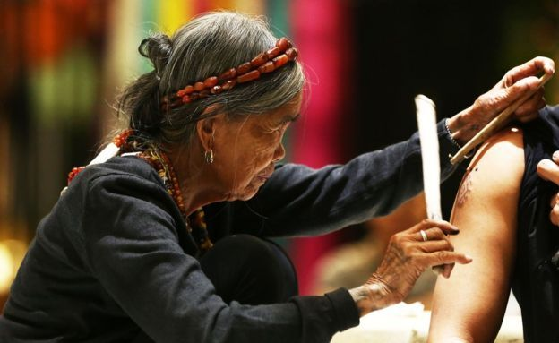 Legendary tattoo master Whang-Od was transported from her tribal village of Buscalan to the capital for the Manila FAME trade show, with the help of the Philippine Army and Air Force. The centenarian, believed to be the country's oldest traditional tattoo artist, performed her ancient craft of hand-tapped Filipino tattoos at the weekend event. Whang-Od hails from a remote mountain tribe in the hills of northern Kalinga province.