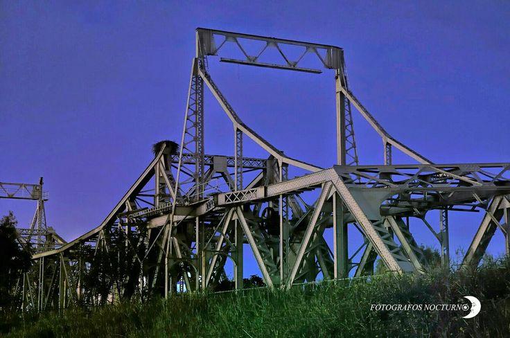 El puente de Alfonso XIII, conocido popularmente como puente de Hierro, es un puente situado en Sevilla (Andalucía, España), y que antiguamente, unía el final de la avenida de la Raza (hoy en día, renombrada como avenida de las Razas) con Tablada y los terrenos que años después se convirtieron en el Real de la feria cruzando el río Guadalquivir a la altura de la corta de Tablada. Fue construido con motivo de la Exposición Iberoamericana de 1929