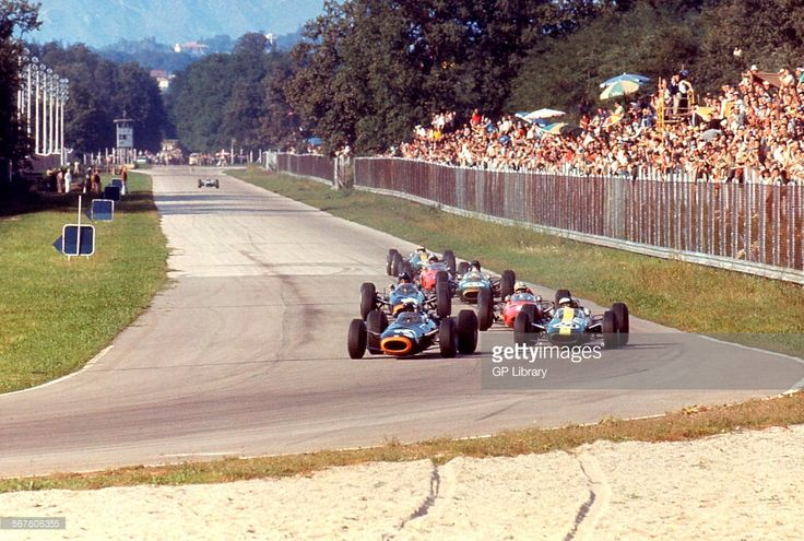 Autodromo Nazionale di Monza - 1965 Italian Grand Prix at Monza in Italy. Stewart on BRM P261 leads Jim Clark in the Lotus, Graham Hill on BRM P261 and Dan Gurney on Brabham-Climax BT11 into the Parabolica. Stewart would go on to win the race.
