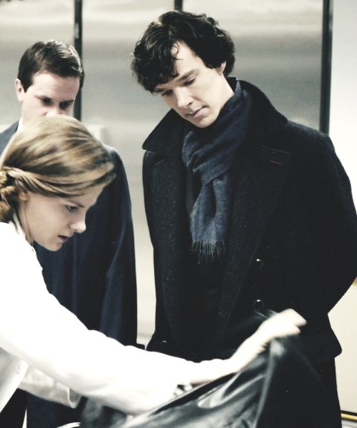 Sherlock & Molly. The Sherlock fandom = The only fandom where two people looking over a dead body can be considered cute.