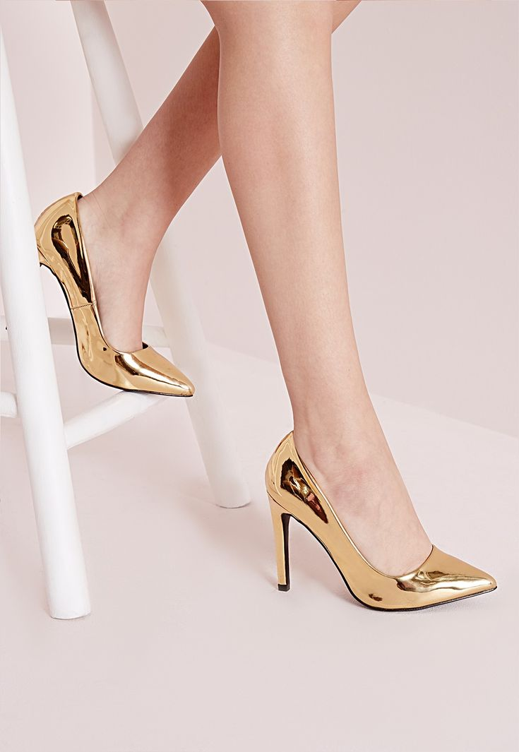 Channel your inner party girl with these super shiny gold pumps. With a pointed toe and seriously stacked heel, these heels are a dream.$42