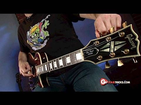Drop D Tuning - Guitar Tuning Lesson-  Guitar Tricks 24