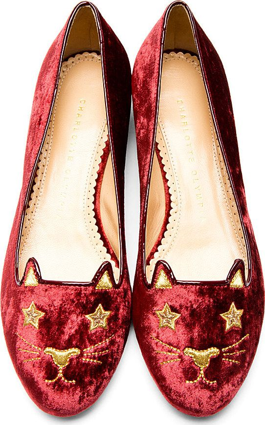 """Burgundy Velvet Kitty & Company Superstar Kitty Flats by Charlotte Olympia. Signature velvet flats in burgundy velvet with gold embroidered kitty face detailing. Glossy patent burgundy piping. 3/4"""" gold-tone stacked heel. Gold-tone spiderweb logo at sole. Tonal stitching. Velvet upper. 100% leather sole. Made in Italy. http://www.zocko.com/z/JIukP"""